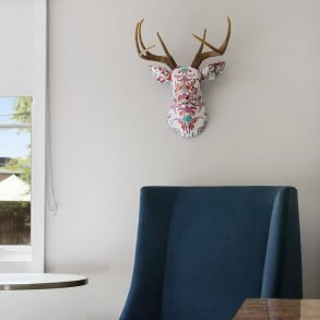 multi color deer painted over chair