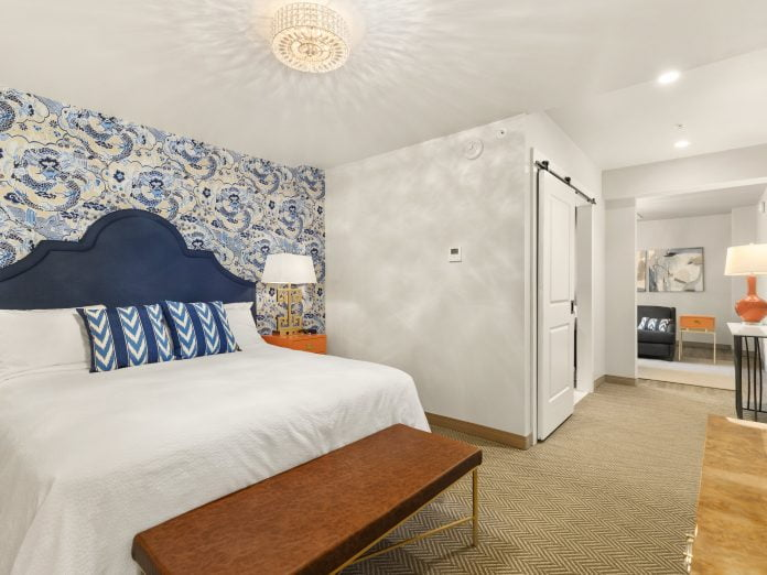 white bedroom with blue and orange details